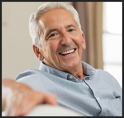 Older man relaxes at home on the couch