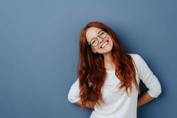 cute red head tilts her head and smiles